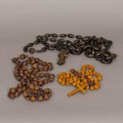 Three carved wooden sets of rosary beads The longest 150 cm long.