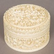 A late 19th century Cantonese carved ivory box Of lidded circular form,