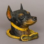A cold painted bronze inkwell Formed as a dog's head inside an entwined riding crop. 14.5 cm high.