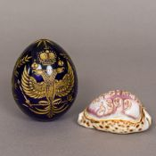 A Russian gilt heightened etched blue glass ornamental egg Decorated with the Russian double headed
