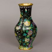 A famille noir cloisonne vase Of lobed bulbous form, decorated with various trailing foliage,