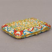 A champleve enamel and silver gilt cigarette case Decorated with scrolling floral sprays,