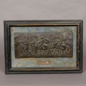 A framed bronzed metal relief plaque In an ebonised velvet lined frame with separate silver plated