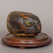 A 19th century preserved taxidermy specimen of a turtle head Set as a table snuff,