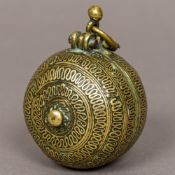 A 19th century Indian brass lime box Of typical circular form, with suspension loop. 8 cm high.