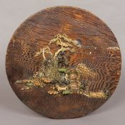 A Japanese Meiji period ivory antler and mother-of-pearl set wooden plaque Of circular form worked