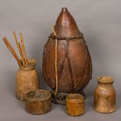 Four African tribal treen pots Together with an African gourd water carrier.