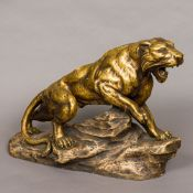 A Belgian bronzed terracotta model of a lion Modelled standing on a rocky outcrop, signed A FAGOTTO,