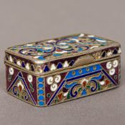 A champleve enamel and silver snuff box Of hinged rectangular form,