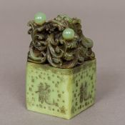 A Chinese carved green stone seal Of square section form,