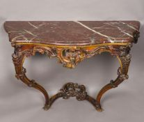 An 18th century Continental carved oak console table The red serpentine marble top above a