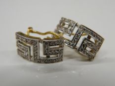 A pair of 18 ct white and yellow gold Greek key earrings. 1.75 cm high (5.5 grammes total weight).