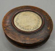 An early 19th century oak circular snuff box. 9 cm diameter.