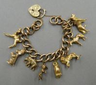 A 9 ct gold charm bracelet set with various charms (71 grammes total weight)