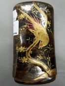 An early 20th century Japanese gilt and red lacquer decorated case. 12 cm high.