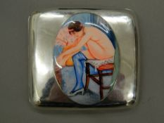 A silver cigarette case decorated with a nude lady. 9 cm wide (127.