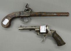 Two antique pistols. Largest 28 cm long.