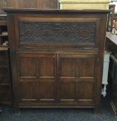 A carved oak side cabinet