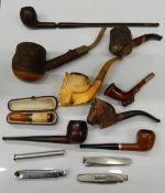 A quantity of pipes and smokers knives/tampers