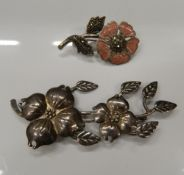 Two silver brooches. Largest 8.5 cm wide (24.