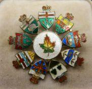 A Canadian sterling silver enamel flag brooch. 4 cm diameter.