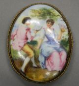 A late 19th/early 20th century Continental painted porcelain brooch. 7.75 cm high.