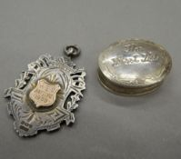 A silver fob inscribed HCC BATTING 1909 and small silver first tooth box.