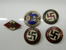 Five Nazi type badges. Largest 2.5 cm diameter.