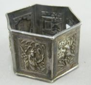 A Chinese silver napkin ring. 5 cm diameter (24 grammes).