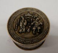 A Chinese round box. 4.5 cm diameter.