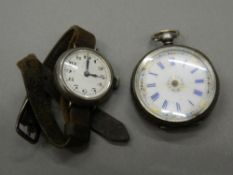 A silver fob watch and a silver cased wristwatch. The former 3.5 cm diameter.