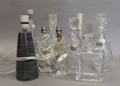 A quantity of various decanters and glass table lamps. Pair of lamps 22 cm high.