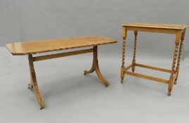 A mahogany coffee table, an oak barley twist side table and another side table.