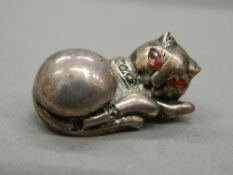 A silver brooch formed as a cat. 3 cm long (8.