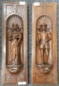 A pair of 19th century carved oak panels depicting a male and female figure. Each 18 x 58.5 cm.