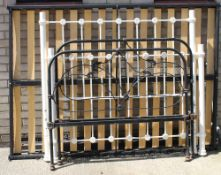 A Victorian iron bedstead and another. The largest 137 cm wide.