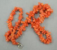 A coral necklace. 42 cm long.