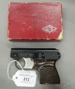 A Mondial Brevettata 1949 calibre 22 starting pistol, boxed.
