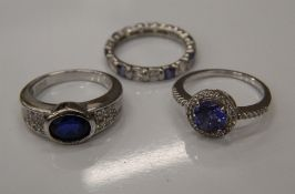 Three silver stone set rings (8.