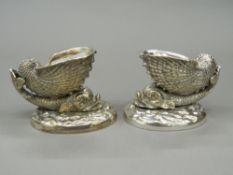 A pair of silver plated dolphin form table salts. 7.5 cm high.