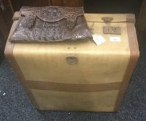 A crocodile skin handbag, together with a vintage suitcase. The case 47 cm wide.