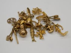 A small 9 ct gold charm bracelet set with various charms (34.3 grammes).