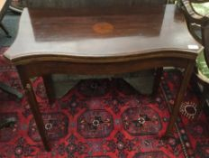 An early 20th century mahogany serpentine card table. 84 cm wide.