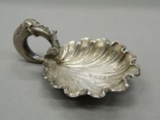 A Victorian silver vine leaf caddy spoon. 7 cm wide (12.5 grammes).
