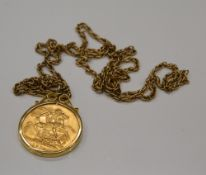 A 1915 gold sovereign in a 9 ct gold mount, on an unmarked chain (16.1 grammes total weight).
