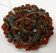 A Chinese carved agate roundel. 7 cm diameter.