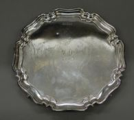 A silver salver. 26 cm diameter (17.4 troy ounces).