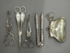 A quantity of plated tongs and a purse. Largest tongs 17.