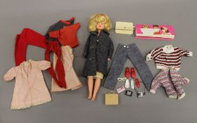 A vintage pedigree Sindy doll with Happy Traveller accessories. 27 cm tall.