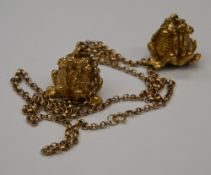 Two 9 ct gold ''See No Evil, Hear No Evil, Speak No Evil'' pendants, one on a 9 ct gold chain.